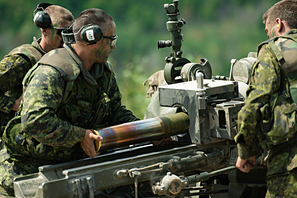 A gunner from 4th Canadian Division loads a shell into the C3 105mm Howitzer during Exercise STALWART GUARDIAN 16 on August 19, 2016 at Garrison Petawawa, Ontario.